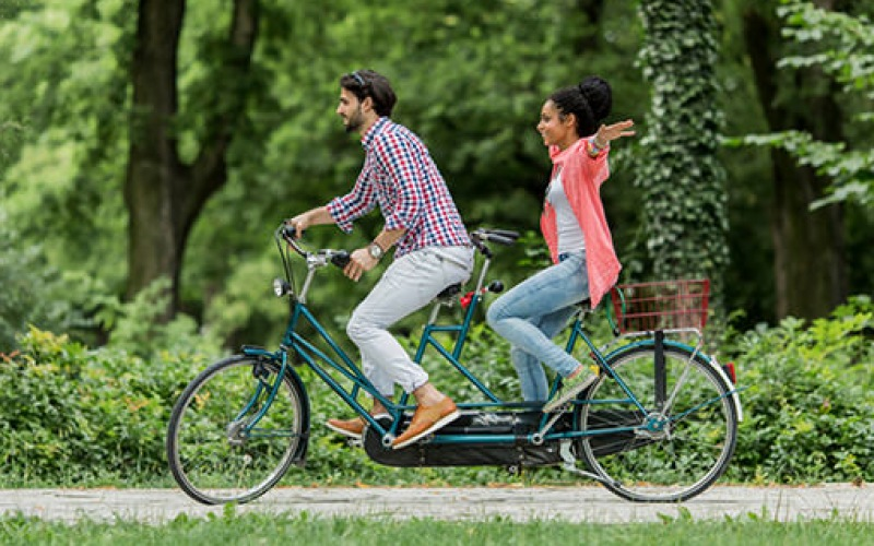 couple riding a two person bike
